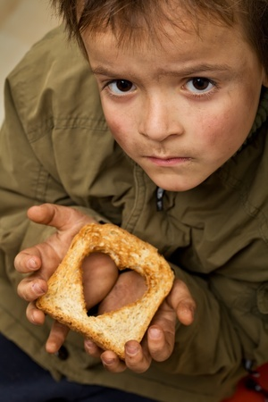 helping others picture young boy with heat shaped hole inside toast